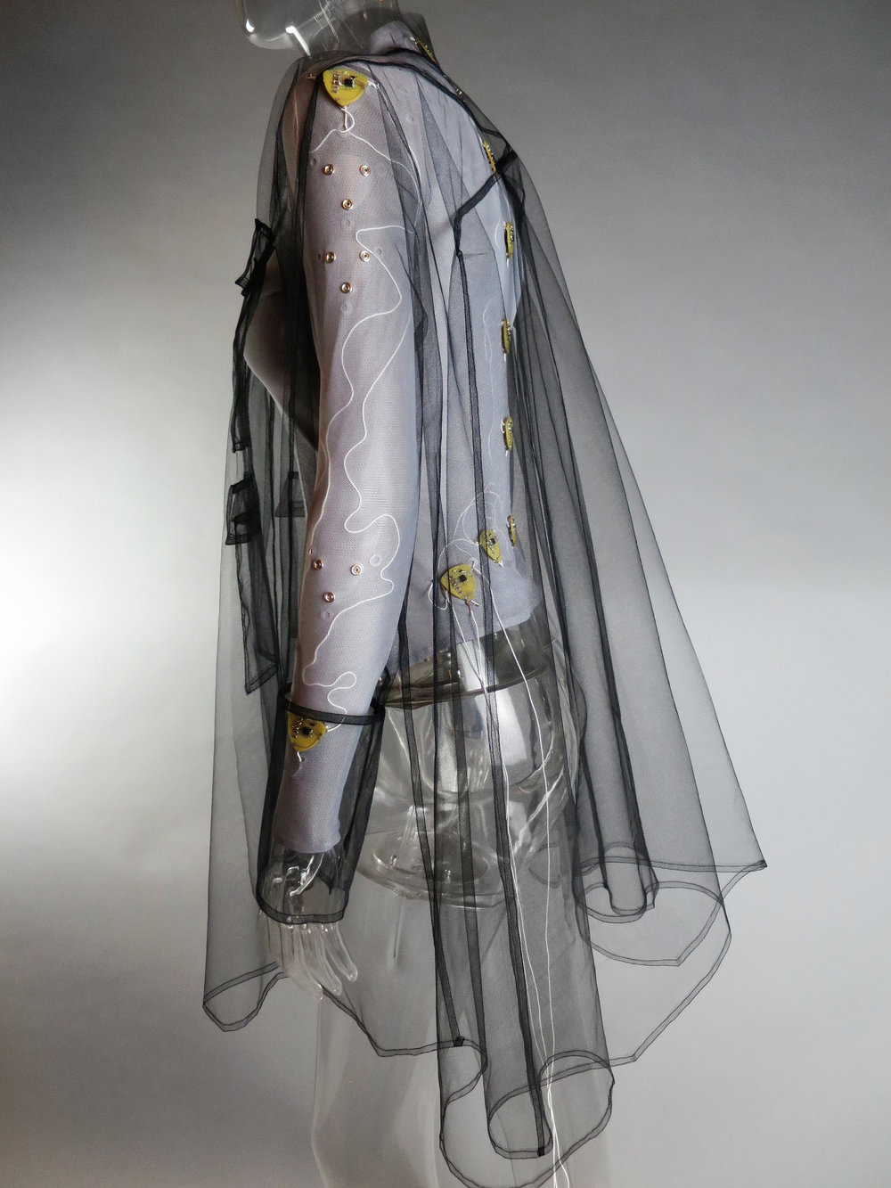 EmobodiSuit by Sophia Brueckner and Rachel Freire. A top covered with wires and actuators that transmit senses such as warmth, coldness, and vibration through data collected to the wearer.